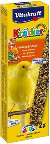 Vitakraft kanarie kracker honingdeze lekkernij bevat verschillende soorten zaden op een natuurlijk houten ...